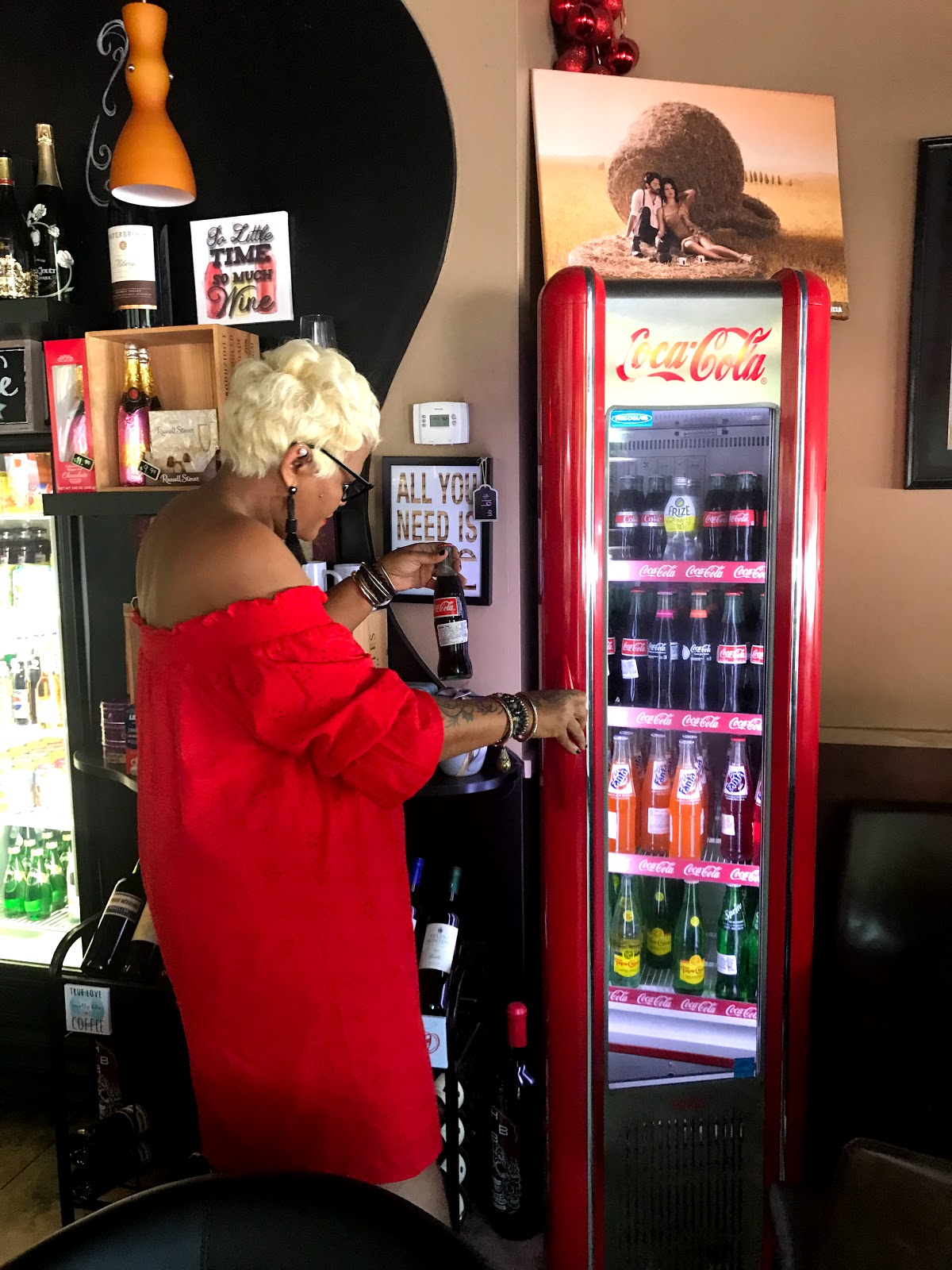 Image: Tangie Bell wearing a red dress and ordering a coke. Talking about Cooter Brown and its meanings. Seen first on Bits and Babbles Blog