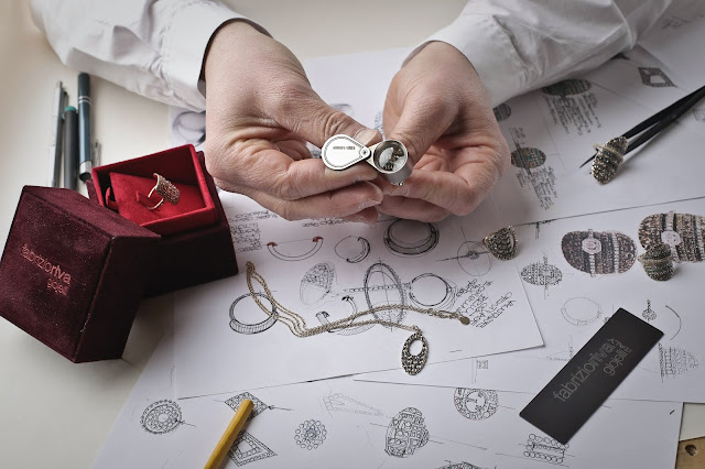 Close up shot of a jeweler inspecting a piece of jewelry.