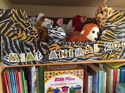 Stuffed toys in a zoo themed box