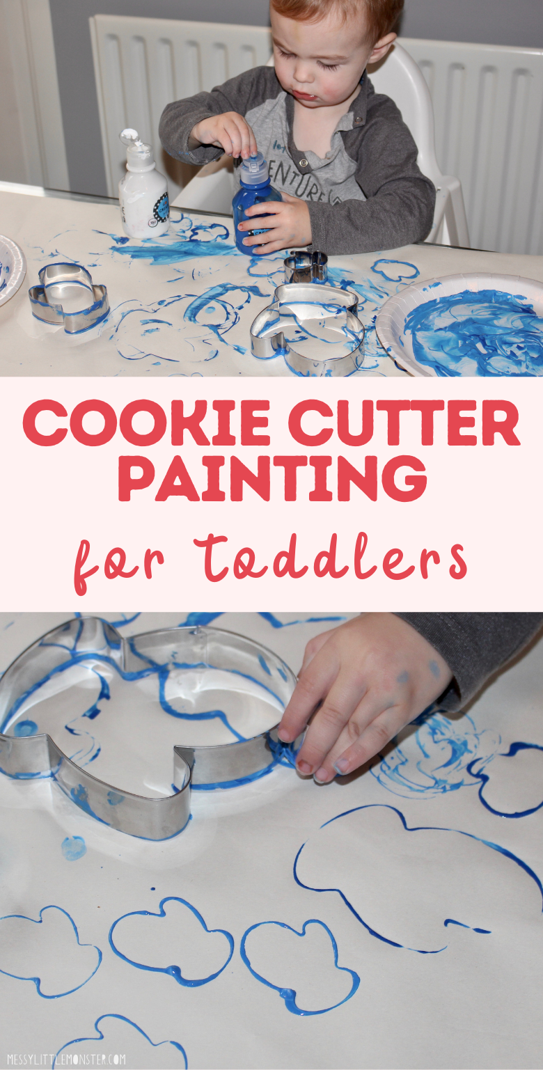 Cookie cutting painting for toddlers. Cookie cutter art. Winter craft for toddlers.