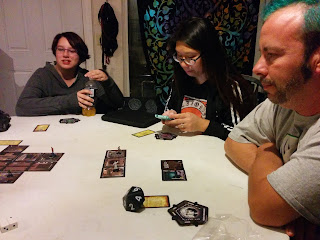 Interviewee John Trobare playing Betrayal at House on the Hill with friends.