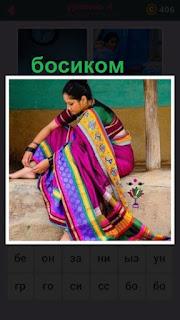 655 слов женщина в сари босиком сидит и одевает ожерелье 4 уровень