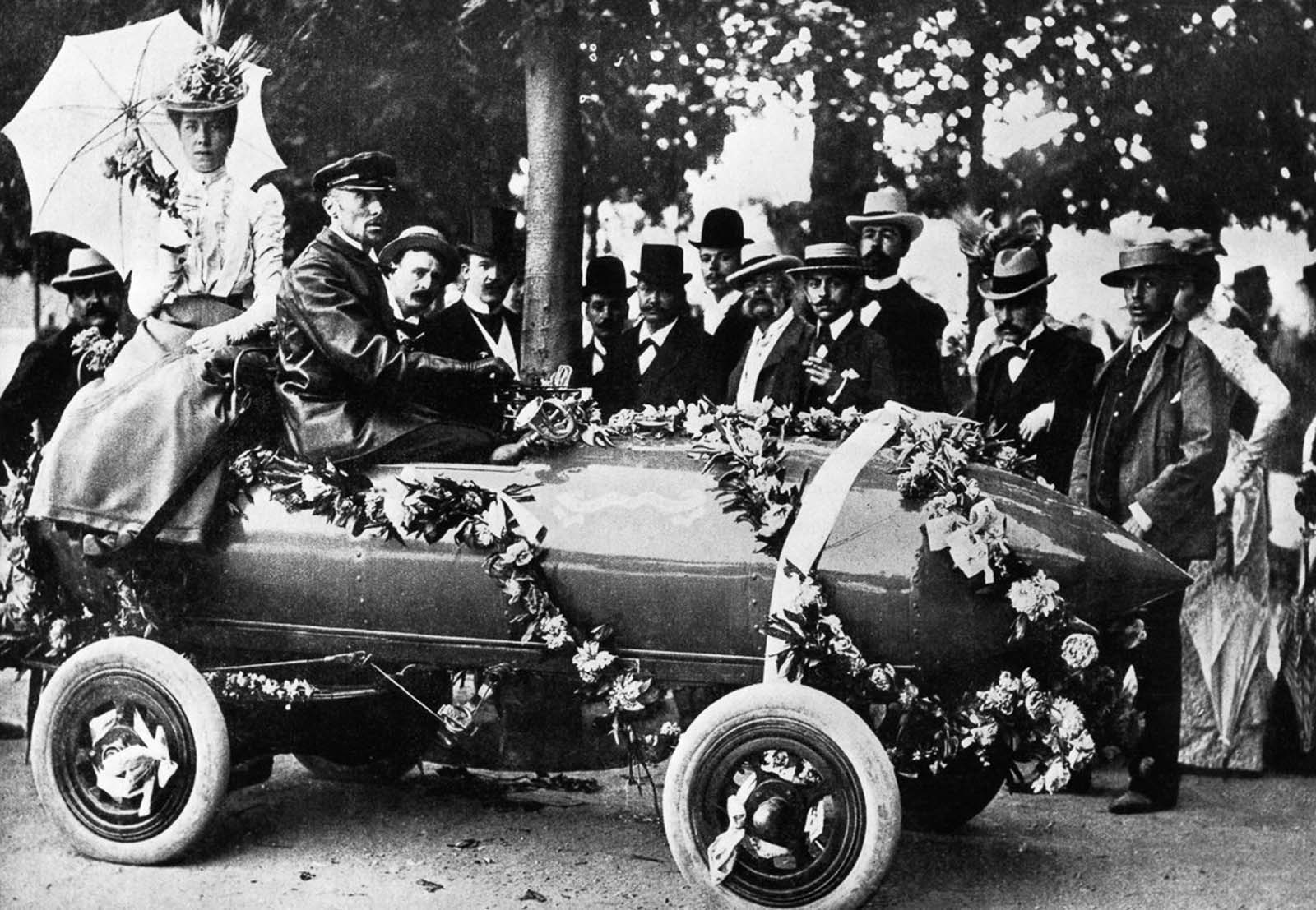 Camille Jenatzy drives his self-designed electric car near Paris, France. He was first person to exceed 100 kilometers per hour (62 miles per hour) in a car. 1899.