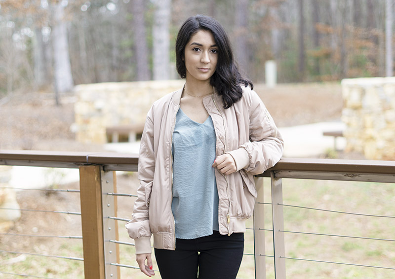 Beige bomber jacket and satin top