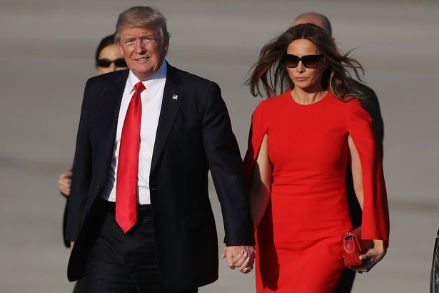 Donald Trump DROPS Melania's hand at her first public appearance