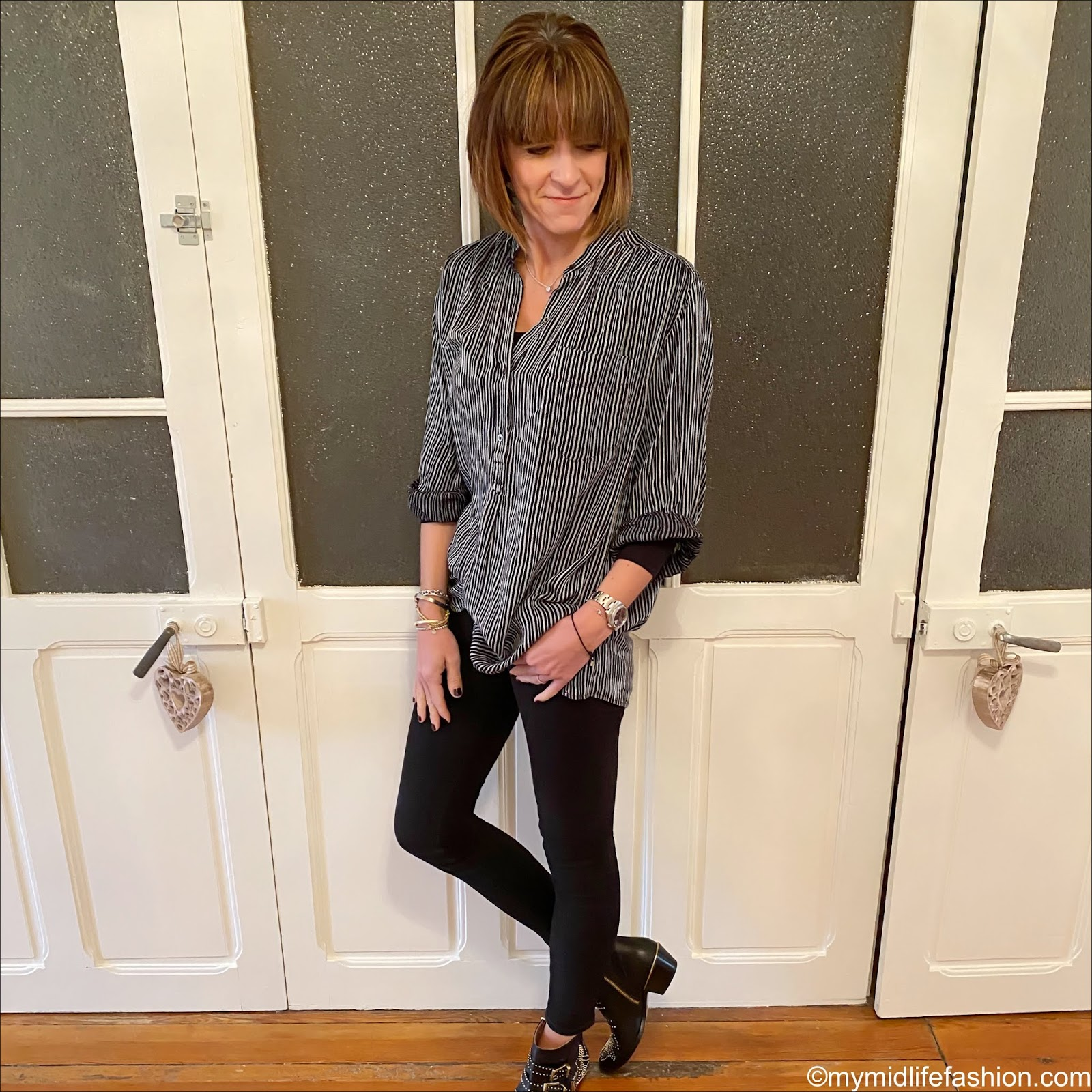my midlife fashion, Uniqlo heat tech top, Isabel Marant Etoile stripe oversized shirt, j crew 8 inch toothpick jeans in true black, Chloe Susanna studded leather ankle boots