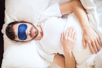 Man sleeping with sleep mask