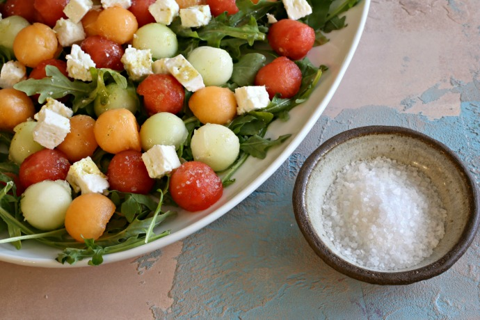 Salad of arugula, fresh melon, feta cheese and a lemon vinaigrette.