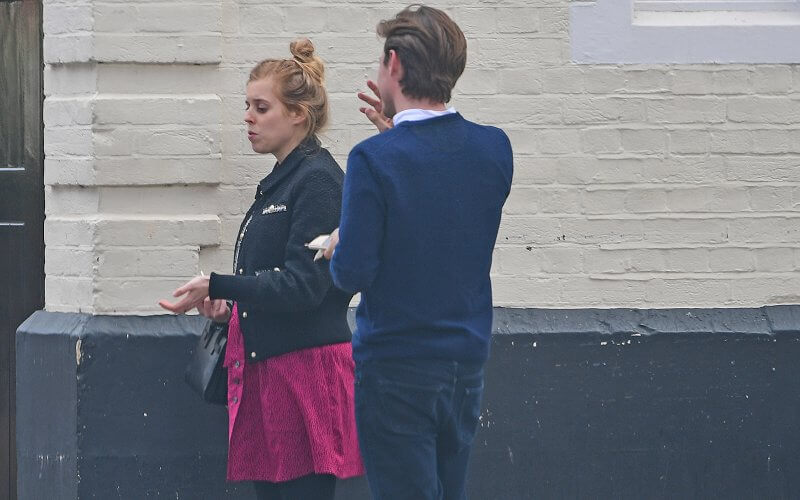 Pregnant Princess Beatrice wore a blobpy black tweed classic-collar jacket from Maje, and black boots from Maje Paris