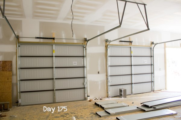 Before The Garage Doors Could Be Installed, The Trim Carpenter Had To  Install 2x4u0027s Around The Openings.