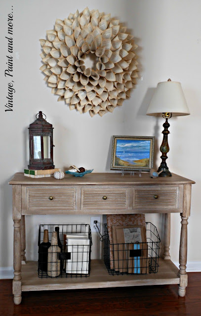 Vintage, Paint and more... summer in the entry with a vintage lantern, seashells and book page wreath