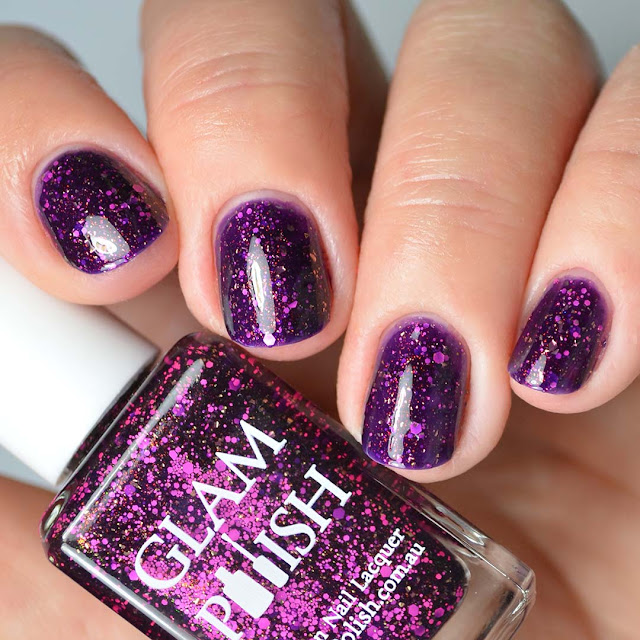 purple nail polish with pink glitter four finger swatch