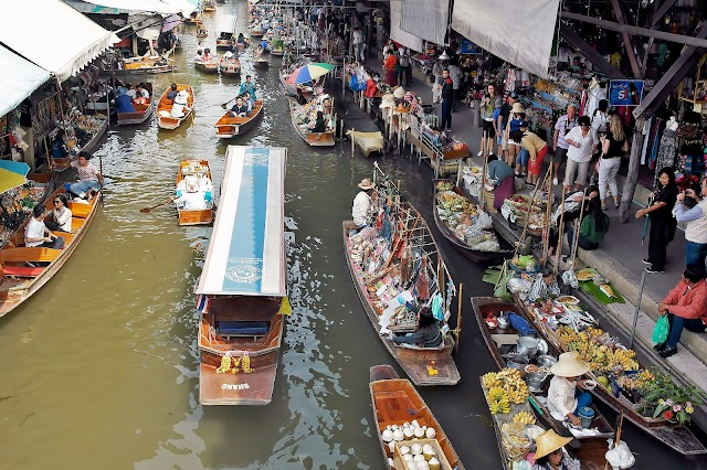 Immerse yourself into hustling floating markets around Bangkok