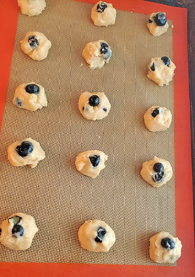 these are blueberry cookies ready for the oven on silipat mat