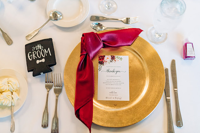 gold and burgundy reception settings
