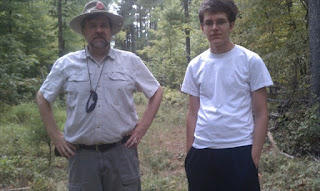 A photo of interviewee J Keller and his son, co-creator Jason Keller, standing outside during a geocaching excursion.