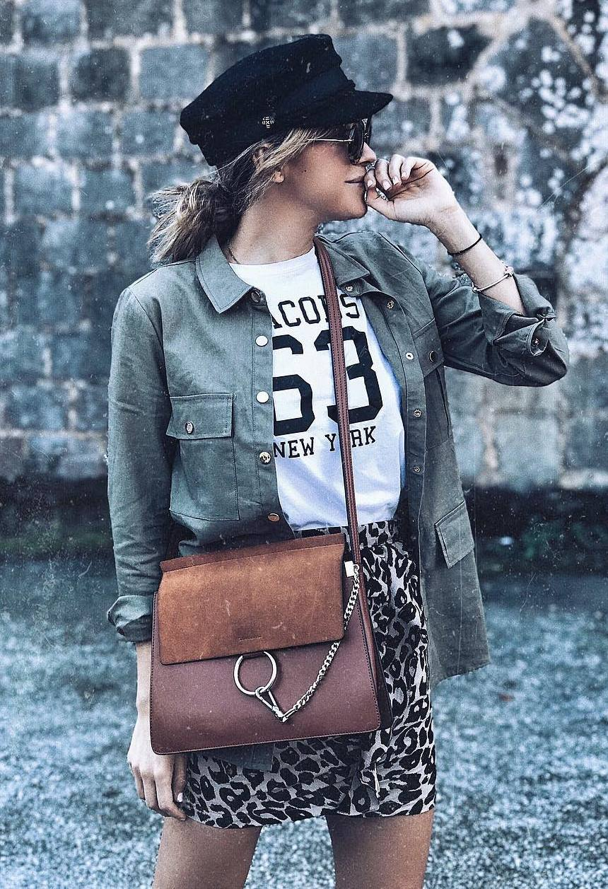 what to wear with a leopard skirt : hat + crossbody bag + jacket + printed top