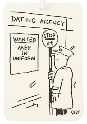 Lollipop man is looking at a poster in the window of a dating agency