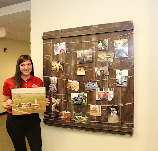 Kayla today with a picture board she put together at our home office