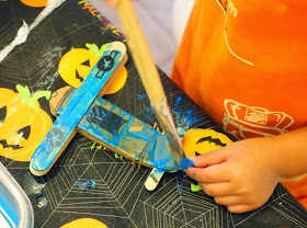 cardboard and popsicle stick biplanes- super easy!