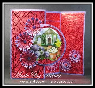 Een dubbele scharnierkaart met een 3d-plaatje en enkele gestanste bloemen.A double hinge card with a 3d picture and some die-cut flowers.