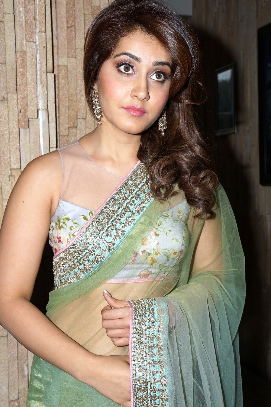 South Indian Atress Rashi Khanna Hot Navel Hip Photos In Transparent Green Saree