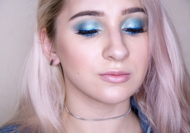 blue eyeshadow and glitter eye makeup