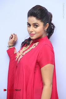 Actress Poorna Latest Stills in Red Dress at Rakshasi First Look Launch  0133.JPG
