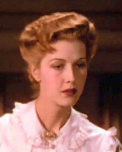Rose Sara's teacher (Anita Louise)