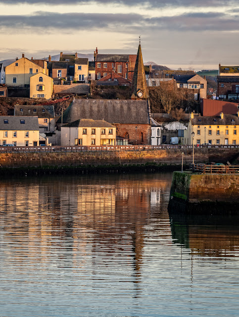 Photo of reflection of Maryport Christ Church on North Quay