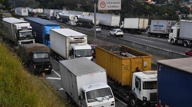 Brazil's President Michel Temer cuts fuel prices to end crisis sparked by truckers' strike