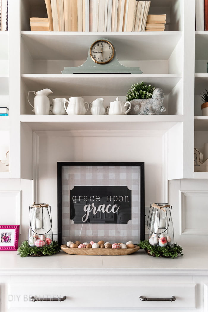 white bookcase styled for Spring