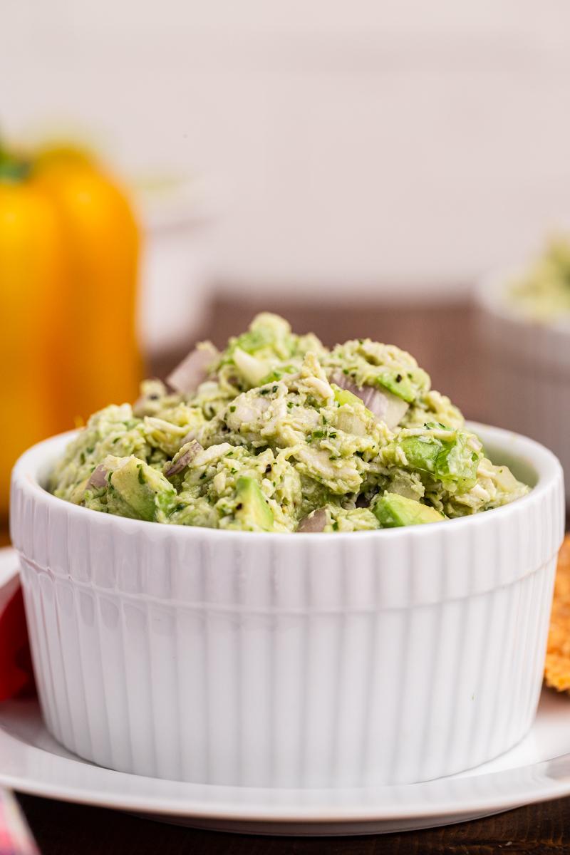 Closeup photo of Keto Avocado Ranch Chicken Salad in a white bowl.