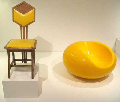 Yellow stilted uncomfortable-looking chair and yellow plastic sensuous chair
