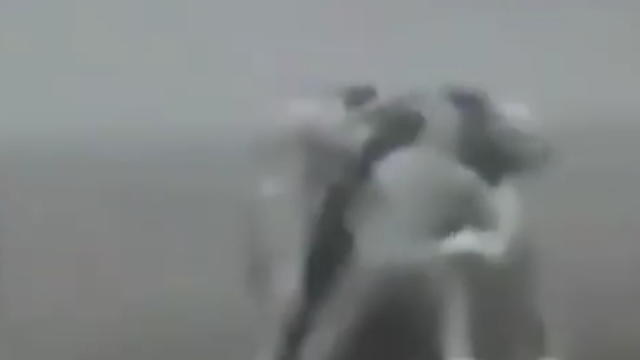 Standing together to carry a UFO to the car on camera in Siberia.