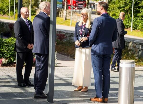 Crown Princess Mette Marit wore a seth double breasted gabardine blazer from Altuzarra, and crepe ivory wide-leg pants from Michael Kors