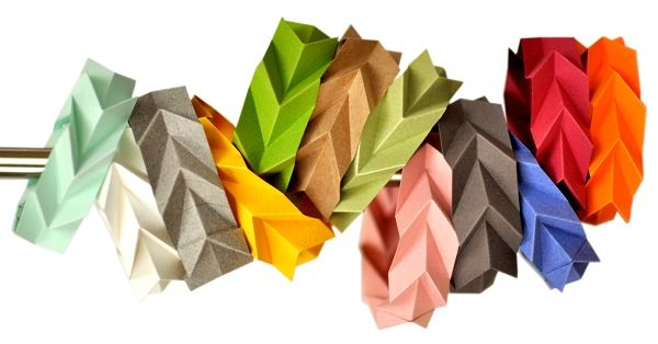 colorful folded paper bracelets displayed on metal rod