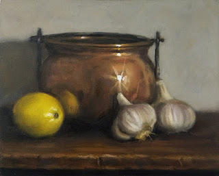 Still life oil painting of a copper pot beside two garlic bulbs and a lemon.