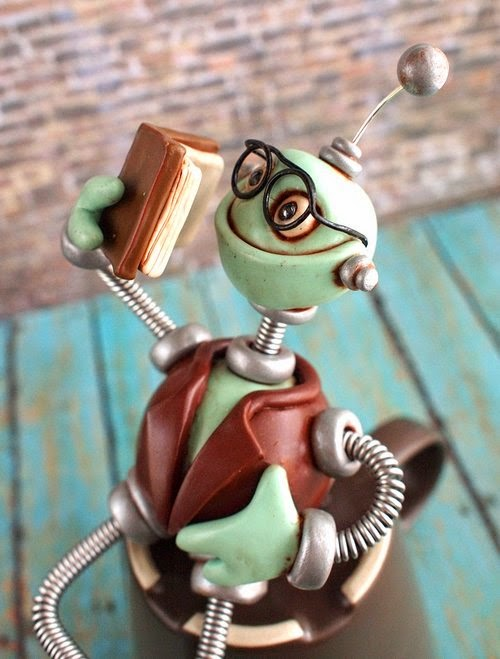 11-Professor-Bot-HerArtSheLoves-Clay-Robot-World-Sculptures-www-designstack-co