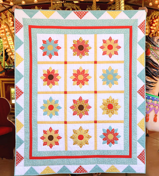 Painter's Palette – Carnival Quilt by Carol Swift of Just Let Me Quilt, The Pattern designed by Riley Blake Designs