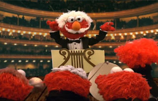 Dorothy imagines Elmo as orchestra chef who conducts and plays in an orchestra. Sesame Street Elmo's World Hands Tickle Me Land