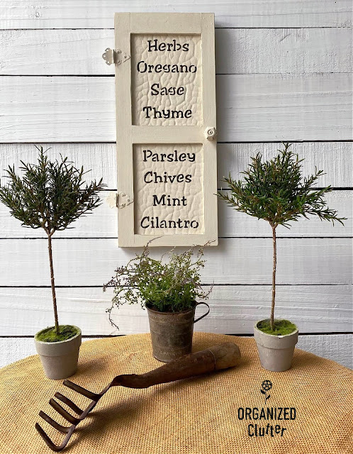 Photo of a farmhouse style wall decor door with herb names