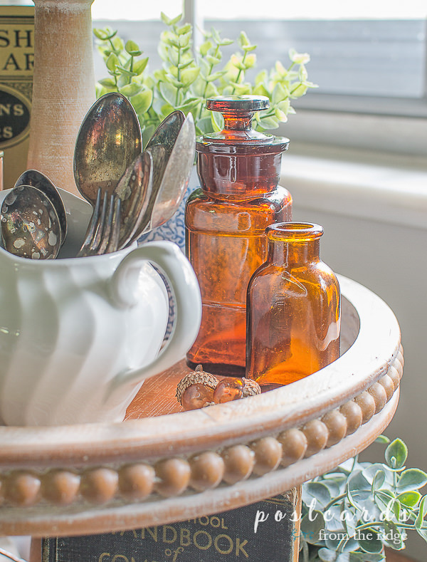 vintage amber bottles used as fall decor