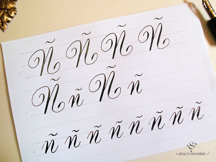 caligrafia copperplate letra enne abecedario ñ