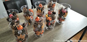 If you're planning a fall wedding, you need to make these DIY Pine Cones And Pumpkins Fall Wedding Centerpieces. Find out how on www.abrideonabudget.com.