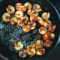 Cooked shrimp in a cast iron skillet