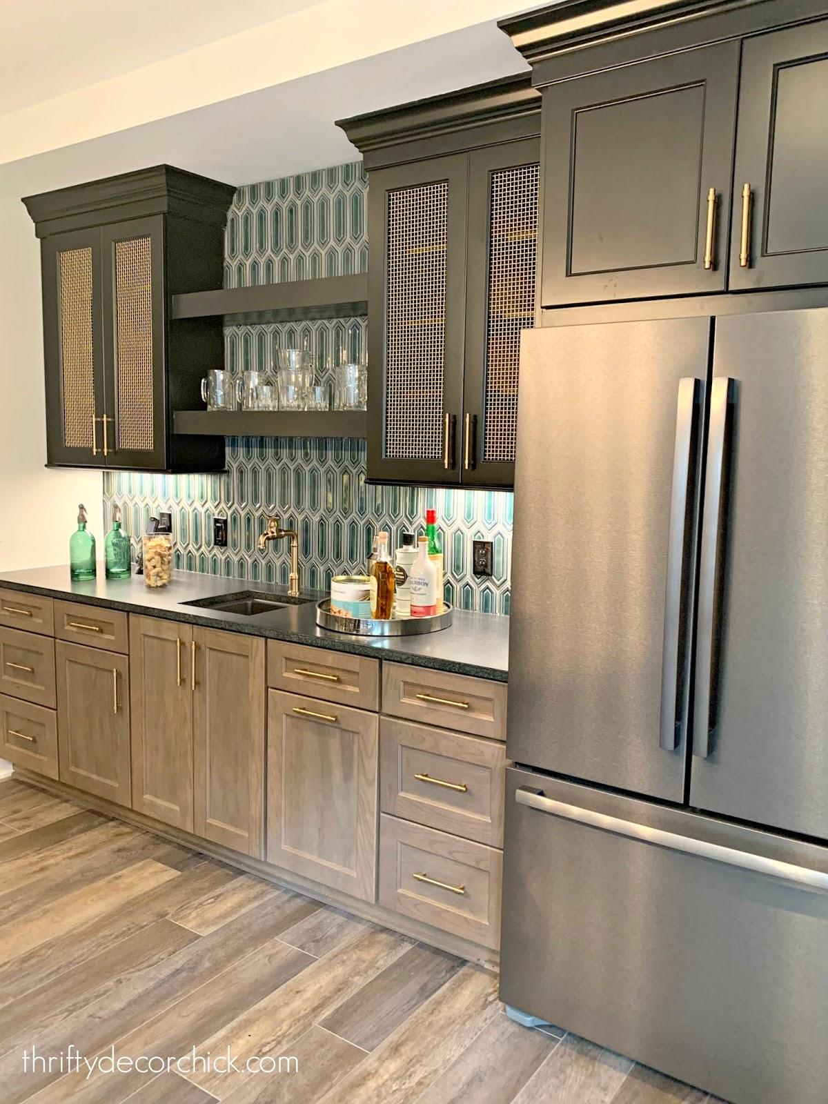 Basement kitchen dark cabinets brass hardware