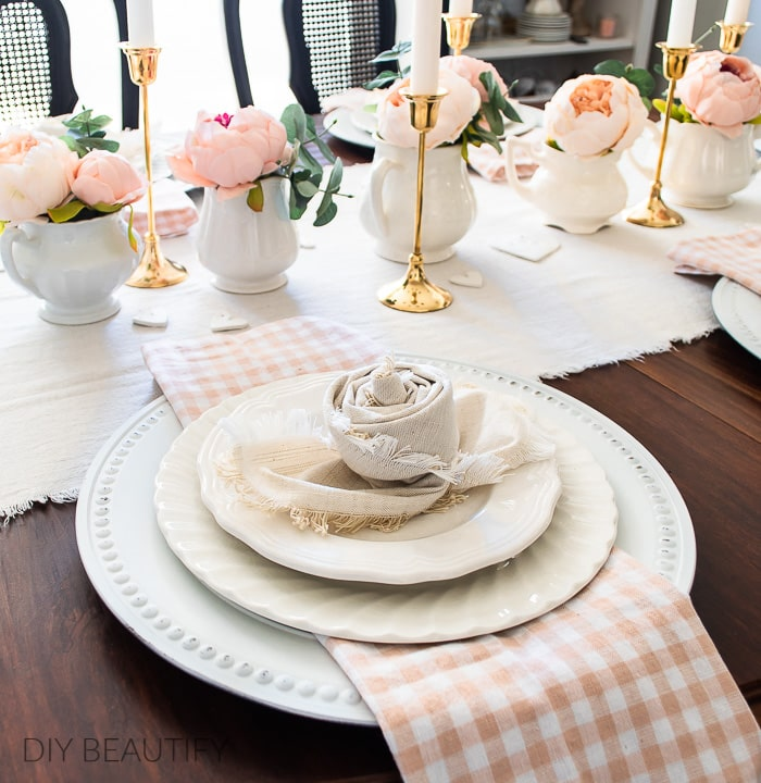 place setting with napkin roses