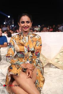 Actress Rakul Preet Singh Stills in Short Dress at Dhruva Pre Release Function  0067.JPG