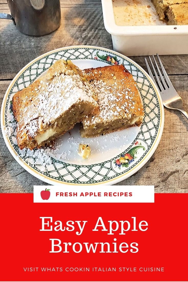 this is a pin for later apple brownie on a plate with powdered sugar on top